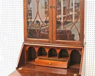 "Burl Mahogany ""Baker Furniture"" Bracket Foot Secretary Desk with Bookcase Top  Auction Estimate $300-$600 – Located Inside"