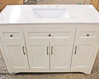 "NEW 48"" Marble Top 4 Door 2 Drawer White Bathroom Vanity with Back Splash  Located Inside – Auction Estimate $200-$400"