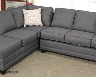NEW Contemporary Grey Upholstered 2 Section Sofa Chaise with Decorator Pillows  Auction Estimate $300-$600 – Located Inside