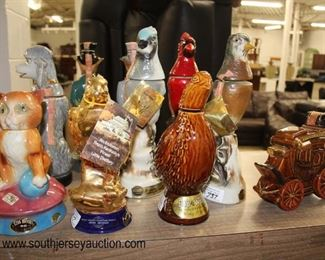 "Large Collection of Figural Decanters including ""Jim Beam"" and some in Boxes  Auction Estimate $10-$50 – Located Glassware"