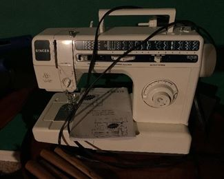 Singer sewing machine and instructions included