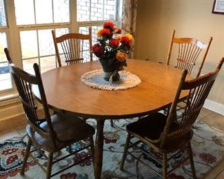 Dining table with 4 chairs and 2leafs $85.00