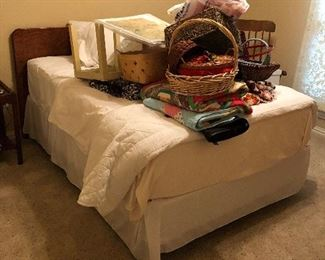 Full size bed with comforter.  Miscellaneous baskets