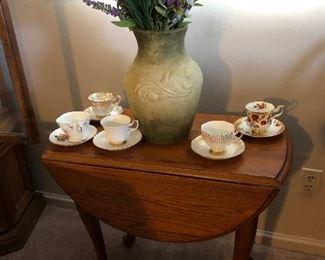 Drop leaf table, fine teacups $10