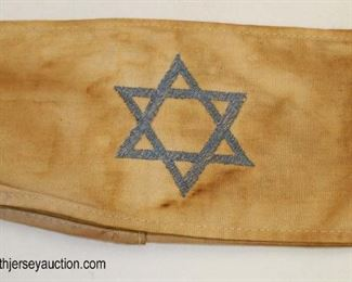 Lot 42: Holocaust style arm band with 6 sided star