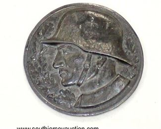 Lot 60: WWII table weight of German soldier with a helmet