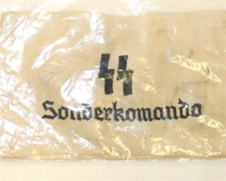Lot 81: Embroidered in service to SS Sonderkomando arm band