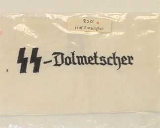 Lot 82: Embroidered in service to SS Dolmetscher arm band