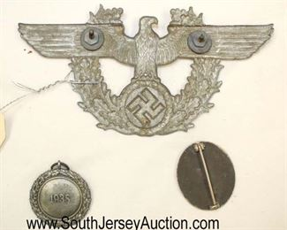 Lot 140: 3pc lot: German Badges including Luftscutze Service Badge, Wound Badge and German Police Car Badge