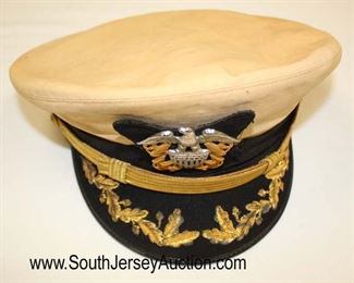 Lot 149: Lot of Personal Effects of Veteran of WWII, Korea, and Vietnam John D. McIntosh including WWII USN Officers Visor Cap, Photo of John D. McIntosh, 2 Military Photos, Front Band, and 2 Extra Hat Covers in the Original Shipping Box