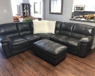 Leather sectional, two ottomans and chair all sold together. Under a year old