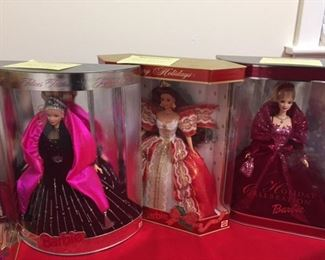 Holiday Barbies from '95, '96, '97, '98, 2002 and Millennium.