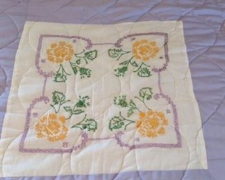 Cross stitch panels on hand made quilt