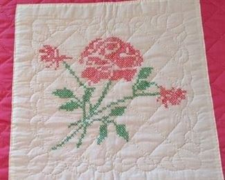 Close up of rose cross stitch motif