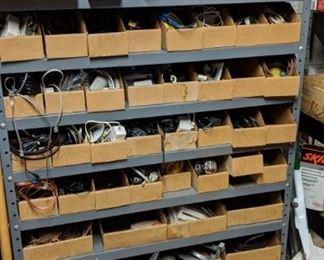 lots of hardware in steel shelving unit