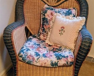 Wicker chair and cross stitch cushion