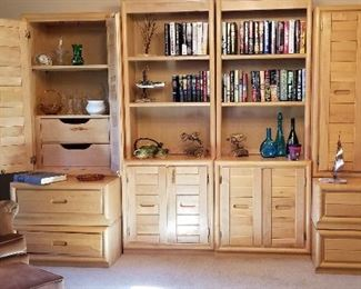 Beautiful light wood Lane furniture. Bookcase/display case that totally disassembles. Lots of storage with 4 big drawers plus inside drawers.