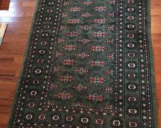 Beautiful green oriental rug, handmade in Pakistan
