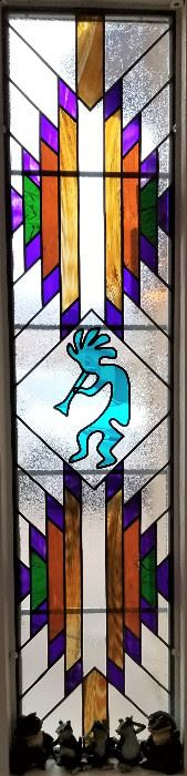 Another gorgeous piece in this home. Long stained glass Southwest window. So beautiful in person.