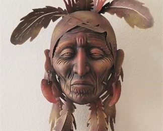 This metal Native American wall mask is too incredible to try to describe! It is 32 inches long. Finely sculpted and detailed. A beautiful piece of art. A real conversation piece.  Just gorgeous.
