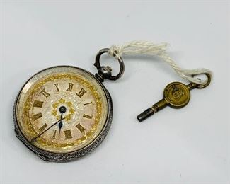 Victorian Era Key Wind, Key Set Pocket watch with real solid yellow gold flakes on the front of the dial.  Watch will wind and set but will not run.  Needs some degree of repair.  Price $150.00