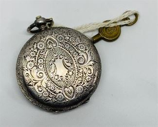 Back side of the Key wind, key set pocket watch, note the watch was never monogrammed, also has the original key.  Price $150.00