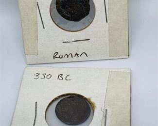 2 Roman Coins 330 BC. I am not a coin expert, so I do not know the ruler or the exact date for these coins.  Both are in display paper and are marked Roman and 330 BC; price is $80.00 for both