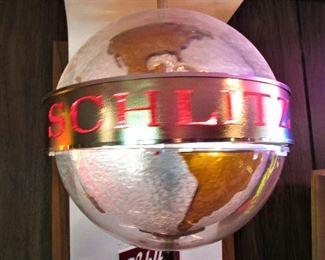 Rotating Schlitz globe light