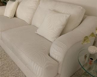 White Sofa in mint condition with out stains.  Non smoking, non pet home.   Throw rug is also of sale.