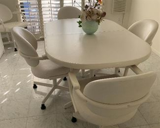 Great chairs!!!  Need I say More?   6 chairs with two inserts.  They don't make them like this anymore.  White seats are very clean1