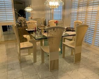 Gorgeous made in Italy Pietro Chairs with Leather Seats.   2 end chairs and 4 side chairs.   Consignment would list chairs at $1600.   Make a reasonable offer.  Chairs can be sold without glass table.  Additional pictures will be posted of dinning table detail. Glass Table 4ftx5ft.