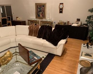 Amazing white leather sectional couch. Complete set of silverware. Art. Brass and copper.