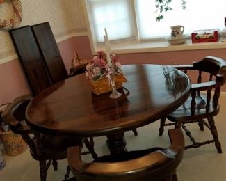 """dark stained pine dining set, table is 48"""" round with two 12"""" leaves (makes table oval) & 4 chairs, matching hutch and server"""