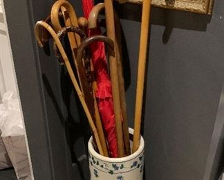 A French umbrella stand filled with canes