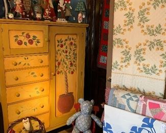 The children's room ! In this section we have a vintage  wardrobe that was painted by our client Jane plus a collection of Santa's and antique quilts