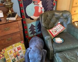 What a great Christmas quilt behind the green leather chair