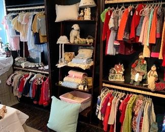A beautiful collection of antique children's cloths and more. Many of the newer pieces have never been worn