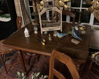 Antique small drop leaf table with sets of chairs perfect for a small meal or a game of cards