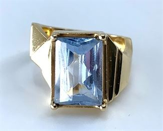 """A beautiful aquamarine, fancy cut with beveled and rounded top with a deep elongated base. Prong set in marked 14K yellow gold and stamped """"BERRY"""". Aprrox size 5, approx dwt 5.7."""