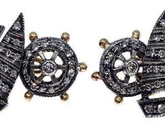 Handsome sterling silver and gold cufflinks designed as sailboats. One side styled as a sailing boat other side a steering wheel, set with single cut diamonds. Total estimated diamond weight 0.44 ct.; overall weight 4.6 gm. Length: .75 in. Condition: Overall good