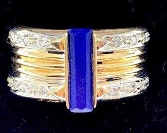14k two tone gold Circle Fine Art (CFA) after Erte band. Set with rectangular cut lapis lazuli measuring 11.5 x 3.5 mm accented with round brilliant cut diamonds. Total estimated diamond weight 0.14 ct., Sl1 clarity, I color. Signed and numbered 19/125 on inside. Overall weight 9.9 gm. Ring Size: 8-8.5 Condition: Very good with minor spots.