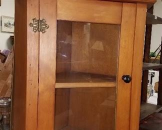 Much primitives. Pine corner/table top cabinet