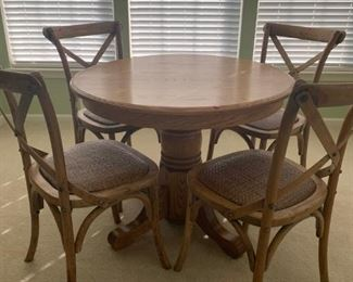 4 chairs and an oak table.  Chairs are locally made.  Desk is oak, does not match chairs.