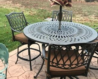 Outdoor table and 4 high swivel chairs.