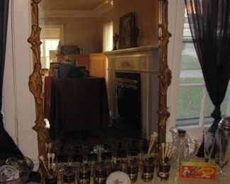 Gilt mirror, Name Your Poison highball glasses by Georges Briard, Skull swizzle sticks