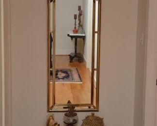 large wall mirror, table