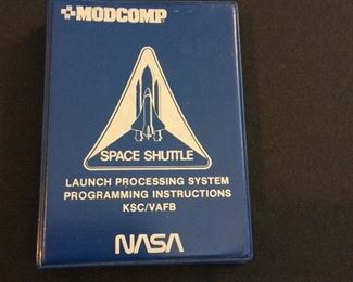 """NASA Space Shuttle MODCOMP Launch Processing System Programming Instructions, 4"""" W x 5 1/2"""" H. Reference Date of 1975."""