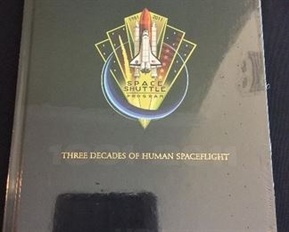 """United Space Alliance Commemorative Package for the successful completion of the NASA Space Shuttle Program. Package includes Commemorative Book that examines the accomplishments of the Space Shuttle Program, Commemorative Video,  and a matted """"End of Space Shuttle Program"""" suitable for framing. Enclosed in an embossed slip case. Book still in original shrink-wrap."""
