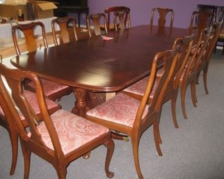 Double pedestal dining table with 3 leaves, pads, and 12 chairs