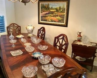 Large dining table and chairs, cut glass, bar cart, art